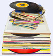 33 and 45 rpm vinyl discs stack on white background
