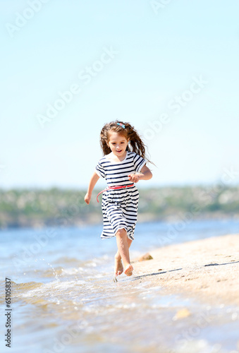 Beautiful little girl on the beach