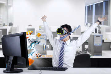 Shocked businessman with snorkeling mask at office