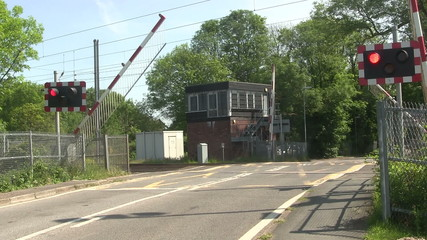 Barrier coming down at a level crossing.
