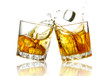 Two whiskey glasses clinking together, isolated