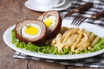 meat stuffed with egg and French fries close-up