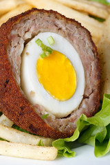 Meat stuffed eggs with french fries and lettuce macro