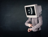 Funny young businessman with a monitor on his head and smiley on