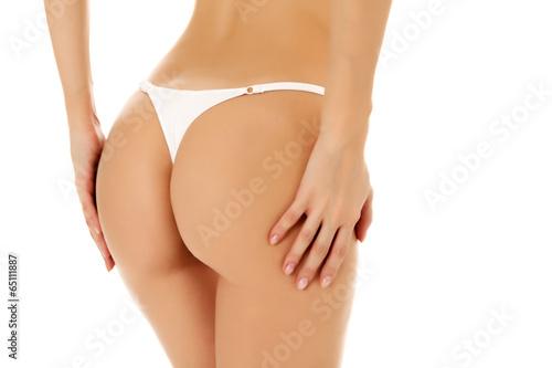 Female butt, white background - 65111887