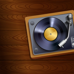 Vinyl record player on wooden background