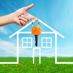 Hand with a house key.