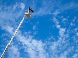 Low angle view of cameraman filming on a crane