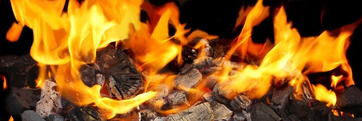 Burning Charcoal close-up in BBQ and Flames in background