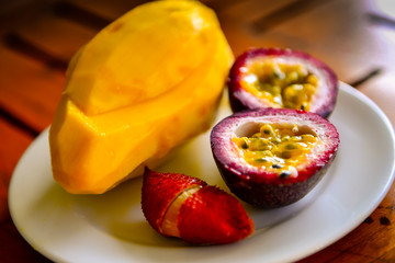 mango and passion fruit on a plate