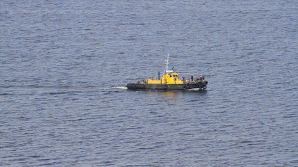 Tug boat sails on a sea