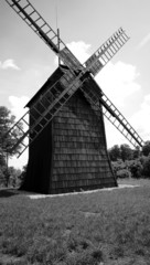 black and white wooden windmill in Poland
