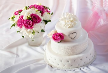 Traditional wedding cake with rose flowers