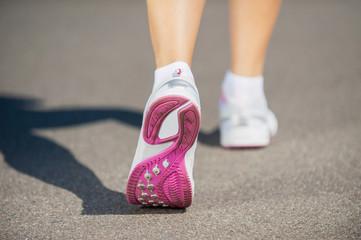 Walking in sports shoes.