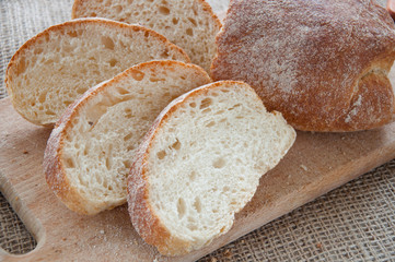 Sliced ciabatta bread on the board