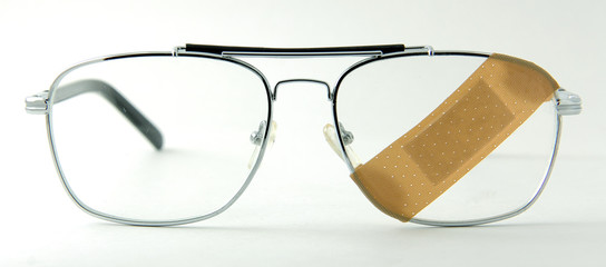 Eye glasses with a band-aid