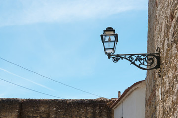 beautiful and traditional view of antique building and lamp in L