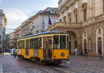 Old tram passing at La Scala theatre in Milan