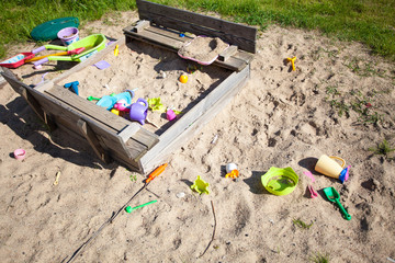 Childhood. Sandpit sandbox with toys on playground.