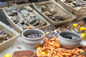 Oysters and shrimps for sale in fish market