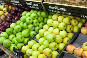 Assorted apples for sale in a supermarket