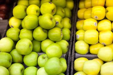 Granny smith and golden apples for sale in a supermarket