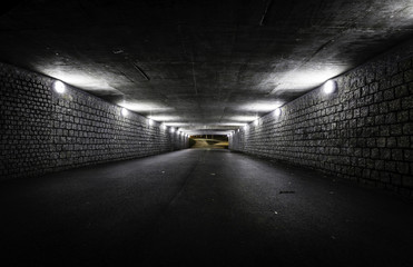 Empty dark tunnel at night