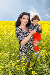 Mother and son in rapeseed field