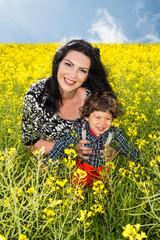 Happy family in rapeseed field