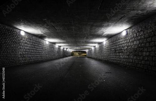 Leinwanddruck Bild Empty dark tunnel at night