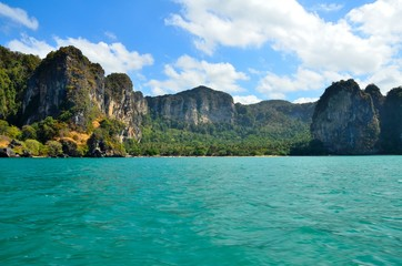 Railay beach with crystal clear water and blue sky.