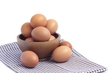 wood bowl with brown eggs