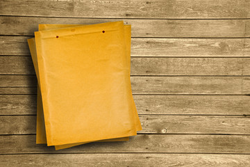 Yellow document envelopes on wooden tabletop