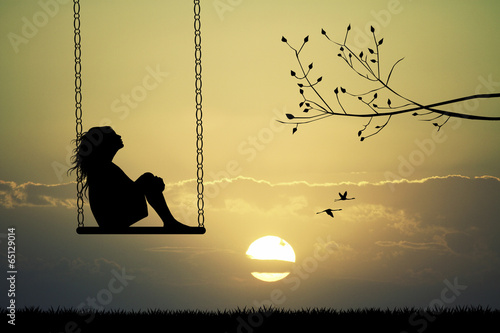 canvas print picture Girl on swing at sunset