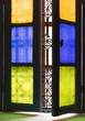 Window with colored glass and arabic grill in Marrakesh - 65130626