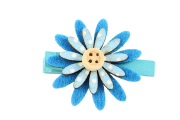blue of artificial flower hairpin isolated on white.