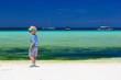 little boy walking on tropical beach