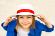 Smiling cute little girl in white hat
