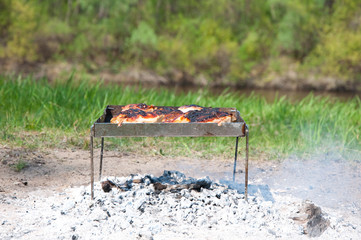 Barbecue on the coals.