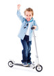 Cheerful boy with raised hand on scooter white background