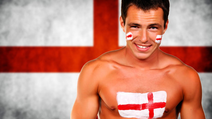 Happy football fan against england national flag