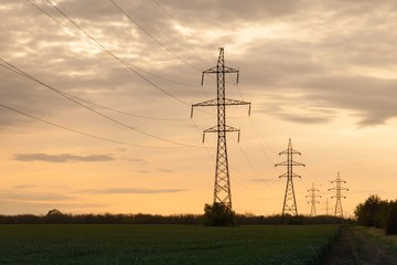 Landscape of silhouette of electricity pylons at sunset