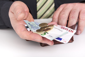Businessman showing the contents of his wallet