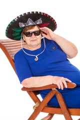 Mature woman relaxing on a lounger