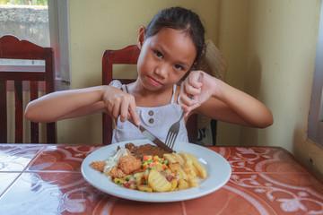 Girl eating Steak
