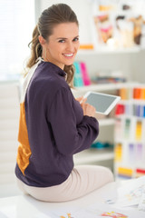 Fashion designer working on tablet pc