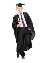 Male graduate holding a diploma