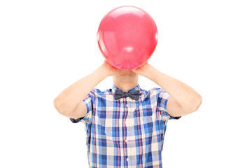Man blowing a balloon