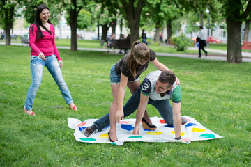 students play the game twister