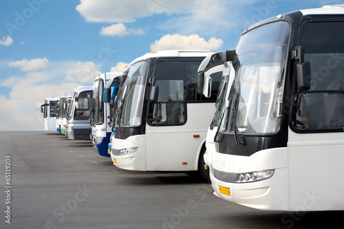 tourist buses on parking - 65139203